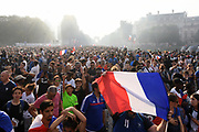 French fans during the parade of the team France on Champ-Elysées after winning the 2018 FIFA World Cup Russia on July 16, 2018 in Paris, France - Photo Philippe Millereau / KMSP / ProSportsImages / DPPI