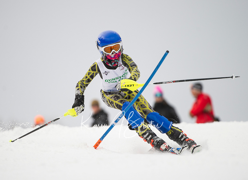 Brady Beland (U12 division) charges through a slalom gate during the annual Gus Pitou Memorial Slalom with Gunstock Ski Club on Sunday.  (Karen Bobotas/for the Laconia Daily Sun)