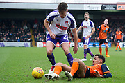 Scunthorpe United midfielder Duane Holmes (19) is tackled by Rotherham United Midfielder Joe Newell (22) during the EFL Sky Bet League 1 match between Scunthorpe United and Rotherham United at Glanford Park, Scunthorpe, England on 10 February 2018. Picture by Craig Zadoroznyj.