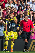 Sofiane Boufal  (Southampton) whispers to goalscorer Nathan Redmond (Southampton) looked on by Kevin Friend (Referee) during the Premier League match between Brighton and Hove Albion and Southampton at the American Express Community Stadium, Brighton and Hove, England on 24 August 2019.