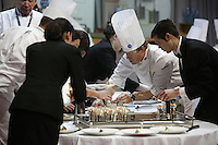 Timothy Hollingsworth, Team USA Chef, preparing plates of his fish dish for the judges,  at the Bocuse d'Or contest