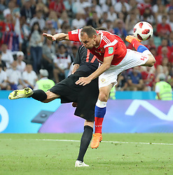 SOCHI, July 7, 2018  Sergey Ignashevich (front) of Russia competes for a header with Mario Mandzukic of Croatia during the 2018 FIFA World Cup quarter-final match between Russia and Croatia in Sochi, Russia, July 7, 2018. (Credit Image: © Cao Can/Xinhua via ZUMA Wire)