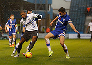 Bury FC Striker & Top Scorer Leon Clarke looks to get passed Gillingham FC defender John Egan during the Sky Bet League 1 match between Gillingham and Bury at the MEMS Priestfield Stadium, Gillingham, England on 14 November 2015. Photo by Andy Walter.