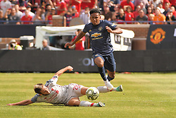 July 28, 2018 - Ann Arbor, MI, U.S. - ANN ARBOR, MI - JULY 28: Liverpool Midfielder Adam Lallana (20) attempts to knock away the ball as Manchester United Defender Demetri Mitchell (35) jumps over during the ICC soccer match between Manchester United FC and Liverpool FC on July 28, 2018 at Michigan Stadium in Ann Arbor, MI. (Photo by Allan Dranberg/Icon Sportswire) (Credit Image: © Allan Dranberg/Icon SMI via ZUMA Press)
