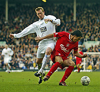 Photo. Jed Wee.<br /> Leeds United v Liverpool, FA Barclaycard Premiership, Elland Road, Liverpool. 29/02/2004.<br /> Liverpool's Milan Baros (R) tries to turn away from Leeds' Steven Caldwell.