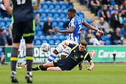 Carlisle United's Shaun Miller  makes a tackle Colchester United's Ryan Jackson(2)  during the EFL Sky Bet League 2 match between Colchester United and Carlisle United at the Weston Homes Community Stadium, Colchester, England on 14 October 2017. Photo by Phil Chaplin