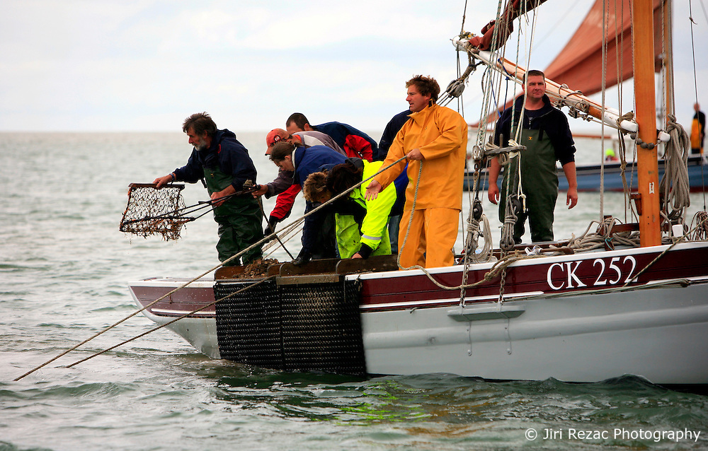UK ENGLAND WEST MERSEA 13SEP09 - The crew of a smack, a historic sailing boat dredge for oysters during the annual Oyster dredge match off the coast of West Mersea, Essex, England.....jre/Photo by Jiri Rezac / WWF UK....© Jiri Rezac 2009