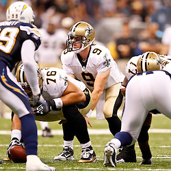 August 27, 2010; New Orleans, LA, USA; New Orleans Saints quarterback Drew Brees (9) under center during the second quarter of a preseason game against the San Diego Chargers at the Louisiana Superdome. Mandatory Credit: Derick E. Hingle