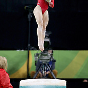 Gymnastics - Olympics: Day 6  Alexandra Raisman #395 of the United States in action on the Vault during her  silver medal performance in the Artistic Gymnastics Women's Individual All-Around Final at the Rio Olympic Arena on August 11, 2016 in Rio de Janeiro, Brazil. (Photo by Tim Clayton/Corbis via Getty Images)