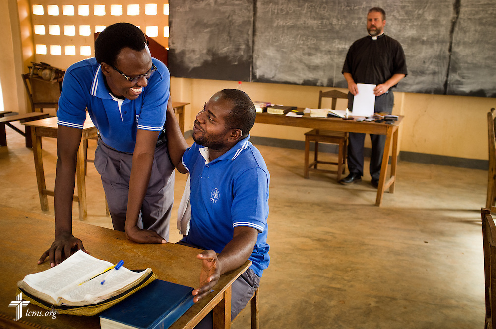 Two students join in fellowship following an exam proctored by the Rev. Micah Wildauer, theological educator and LCMS missionary to Togo, at the Lutheran Center for Theological Studies (CLET) on Wednesday, Feb. 15, 2017, in Dapaong, Togo. LCMS Communications/Erik M. Lunsford