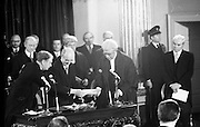 Inaugeration of Cearbhall O'Dalaigh as President  (H77).1974..19.12.1974..12.19.1974..19th December 1974..Following the sudden death of President Erskine Childers, Mr Cearbhall O'Dalaigh was nominated by The Fianna Fail party as its candidate to replace him. The Fine Gael /Labour coalition government did not oppose the nomination and Mr O'Dalaigh was elected un-opposed on a joint party agreement...Watched by An Taoiseach,Liam Cosgrave and Chief Justice O'Higgins, Cearbhall O'Dalaigh is pictured signing the oath of office conferring on him the Presidency of Ireland