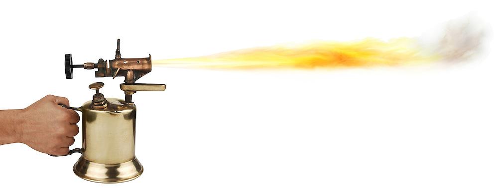 vintage brass blowtorch on white background