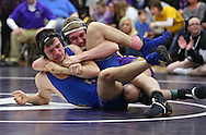 Alburnett's Grant Henderson (right) controls Wilton's Kaleb Schmidt during the 152-pound bout in the Class 1A Wrestling Regional between Alburnett and Wilton at Alburnett High School in Alburnett on Tuesday, February 5, 2013. Henderson defeated Schmidt with a fall. (Stephen Mally/Freelance)