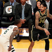 30 March 2018: Milwaukee Bucks guard Eric Bledsoe (6) defends on Los Angeles Lakers forward Brandon Ingram (14) during the Milwaukee Bucks 124-122 victory over the LA Lakers, at the Staples Center, Los Angeles, California, USA.