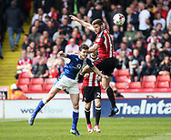 Sheffield United's Jack O'Connell tussles with Chesterfield's Paul McGinn during the League One match at Bramall Lane, Sheffield. Picture date: April 30th, 2017. Pic David Klein/Sportimage