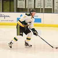 2nd year defence man Tyler King (7) of the Regina Cougars in action during the Men's Hockey home game on February 3 at Co-operators arena. Credit: Arthur Ward/Arthur Images