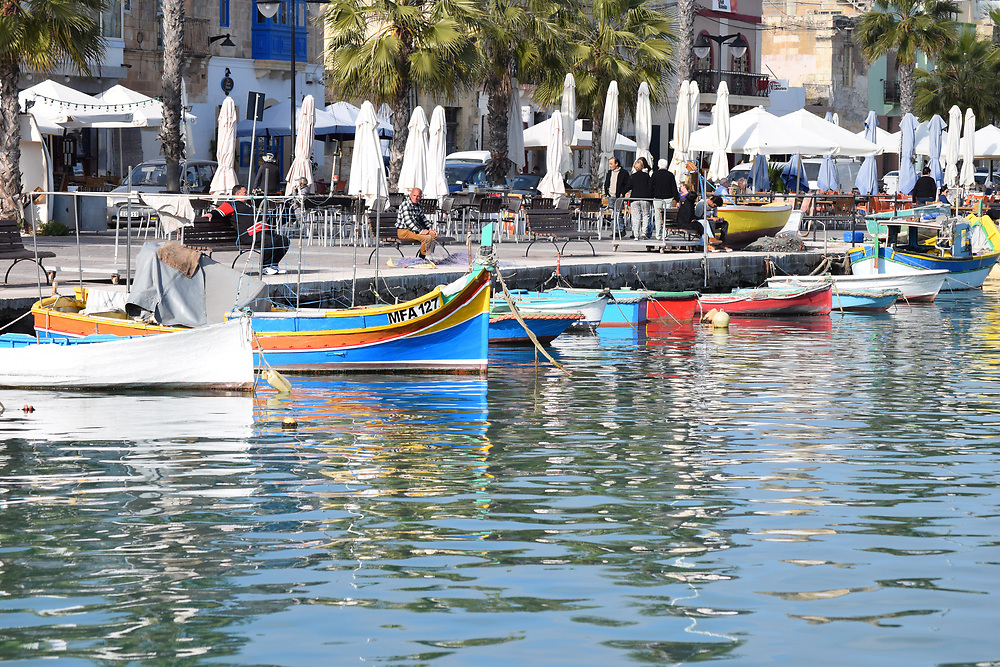 Fishing boats moored at the quayside in Marsaxlokk