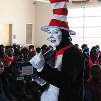 RAY VAN DUSEN/BUY AT PHOTOS.MONROECOUNTYJOURNAL.COM<br /> Retired Tupelo teacher Sherry Latham dons a Cat in the Hat costume to read the book by the same name for students at Belle-Shivers Middle School.