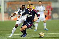 FOOTBALL - FRENCH LEAGUE CUP 2011/2012 - 1/2 FINAL - FC LORIENT v OLYMPIQUE LYONNAIS - 31/01/2012 - PHOTO PASCAL ALLEE / DPPI - KIM KALLSTROM (OL) / INNOCENT EMEGHARA (FCL)