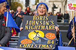 © Licensed to London News Pictures. 30/10/2019. London, UK. A Brexit protester holds 'BORIS JOHNSON'S NIGHTMARE B4 CHRISTMAS' halloween sign outside Houses of Parliament. On Tuesday 29 October 2019 MPs voted for a UK general election on 12 December 2019. Photo credit: Dinendra Haria/LNP