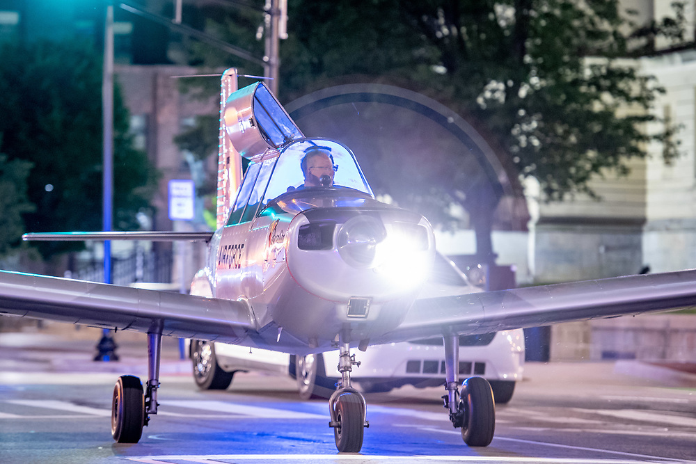 "June 2, 2018; Damian Dieter taxies his Varga Kachina aircraft through downtown South Bend while returning it to its hangar following a static display as part of the ""Best Week Ever"" celebration. (Photo by Matt Cashore)"