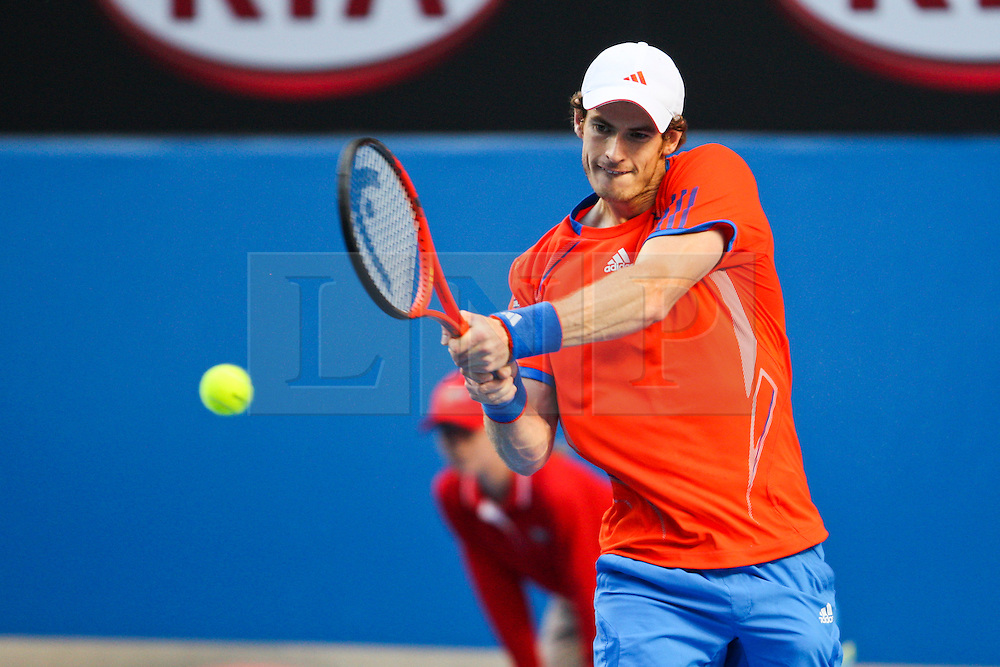© Licensed to London News Pictures. 21/01/2012. Melbourne Park, Australia. Andy Murray (GBR) plays a backhand shot in his men's singles match against Michael Llodra (FRA) during the 6th day, round 3 of the Australian Open. Photo credit : Asanka Brendon Ratnayake/LNP