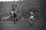 Kerry's forward jumps highest in a tussle for possession during the All Ireland Senior Gaelic Football Final Kerry v Down in Croke Park on the 22nd September 1968. Down 2-12 Kerry 1-13.