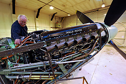 "© Licensed to London News Pictures. File picture dated 13/12/2012. Bristol, UK. Peter Dean works on a Rolls-Royce Merlin engine. Engineers race to finish work rebuilding a Mark IX Spitfire fighter circa 1943, at Filton airfield near Bristol. The plane has been rebuilt  by John Hart engineering, it is the last plane to be completed at the airfield and was flown out on 18 December 2012 by pilot Bill Perrins. Filton, the birthplace of the British-built Concorde jets, is to close on Friday (21st December 2012). Its owner BAE Systems says it is not viable and intends to sell it for housing and business development. BAE Systems said the airfield was closing following a comprehensive assessment over a five-year period and an independent review, ""both of which concluded that the airfield was not economically viable"".  Airbus has said it is fully committed to the Filton site, where it has a base making aircraft wings.  A spokesman said: ""The closure of the airfield will have no significant effect on our business and we have mitigation plans in place regarding the change of venue for our passenger shuttle (using Bristol airport) and the transportation of the A400M wings (via Portbury docks).  Planes currently based at Filton will have to find new homes. The airfield officially closes for flights this Friday, though the police helicopter will still be based there. BAE is supporting a new museum at Filton to ""house Concorde Alpha-Foxtrot and Bristol's aviation heritage."".Photo credit : Simon Chapman/LNP"