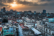 Warm light on Havana at sunset highlights the intricacy and disrepair of the city's historic architecture.