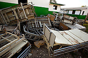 L'Hopital la Providence des Gonaives resembles a ghost town as it stands empty and in disrepair from the damages it received during the floods in September, 2008. Some of the patients drowned during the worst of the flooding, and the bodies of the victims were stacked up outside in a makeshift morgue. Officials from the International Committee of the Red Cross finally decided they had no choice but to bury the bodies of the victims that remained in mass graves.
