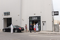 DUBAI, UAE - APRIL 30, 2016: Visitors are leaving the The MB&F M.A.D. (Mechanical Art Devices) Gallery located in Alserkal Avenue in Dubai' Al Quoz Industrial Area.
