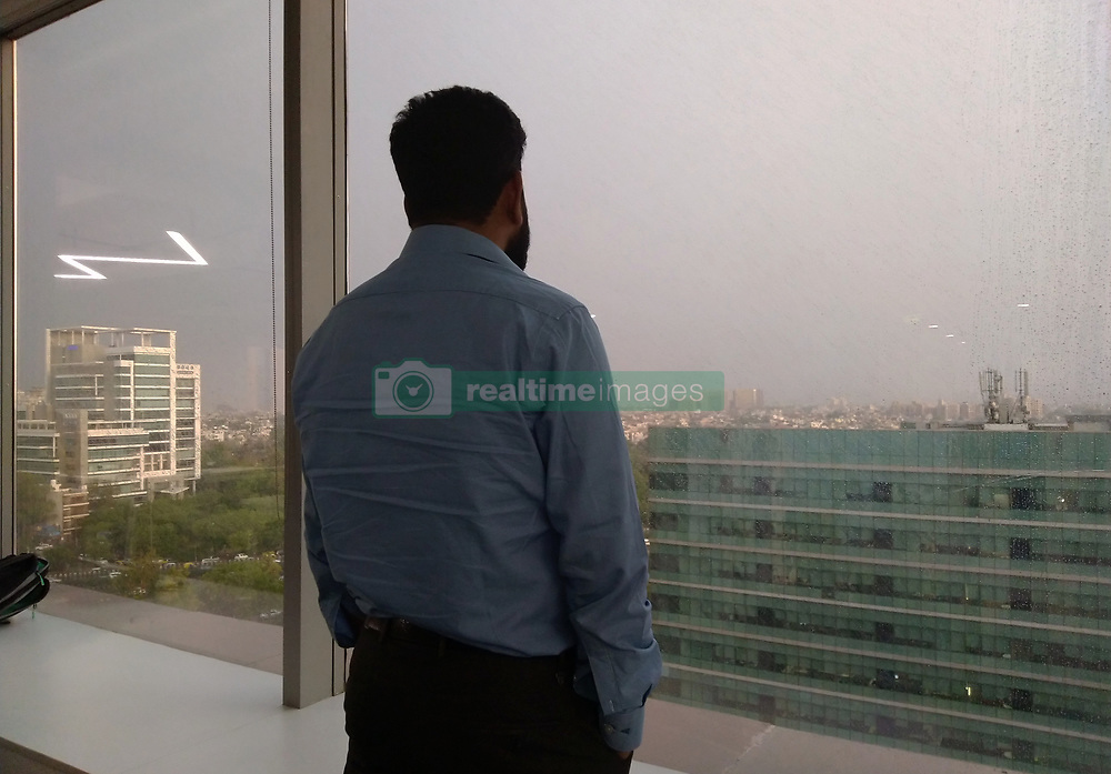 May 3, 2019 - New Delhi, India - A man looks through the Glass as it rains in Delhi-NCR on May 3, 2019. For Friday, the Indian Meteorological has predicted generally cloudy sky with light rain or drizzle. (Credit Image: © Nasir Kachroo/NurPhoto via ZUMA Press)