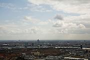 Nederland, Noord-Holland, Amsterdam, 16-04-2008; Amsterdam-Noord, het IJ en een overzicht van de stad; onder in beeld de Klaprozenweg en het water van het Johan van Hasseltkanaal; midden Mosplein met hotel (geel gebouw), rechts (aan het IJ) Overhoeks (het groene gebouw, voorheen Shell) en daar achter het Centraal Station; achter het CS rechts onder de horizon, de RAI; links van het station de dubbele toren van de Nederlandse bank; midden links Rembrandt toren (en Mondriaan en Breitner tower), rond het Amstelstation, daar weer linsk van (het dak van) de Arena;..luchtfoto (toeslag); aerial photo (additional fee required); .foto Siebe Swart / photo Siebe Swart.