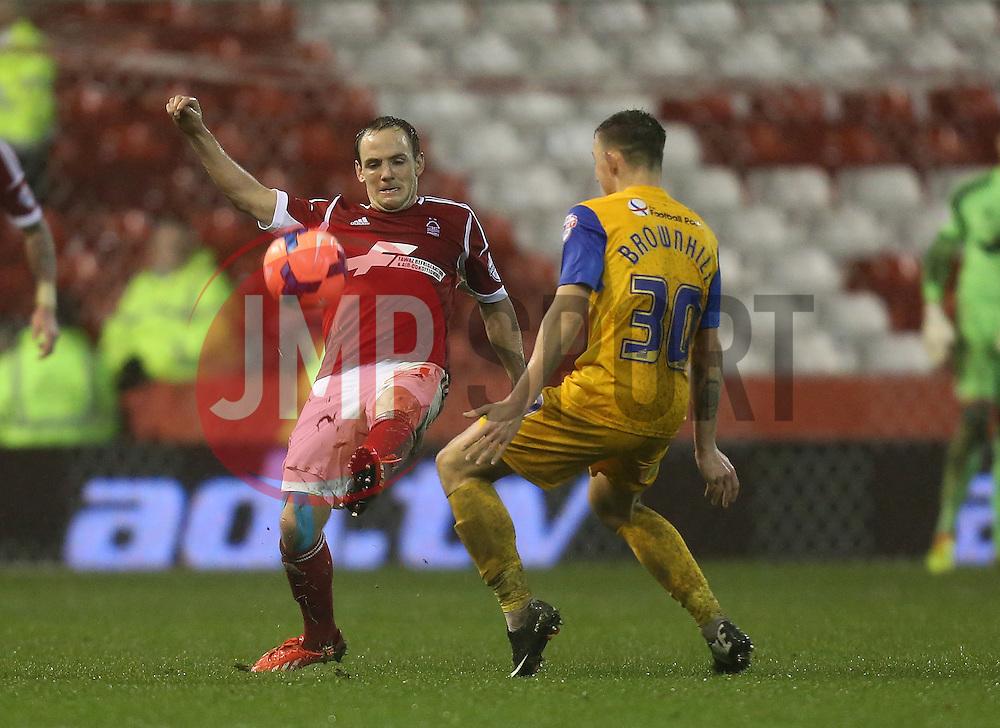 Nottingham Forest's David Vaughan battles with Preston North End's Josh Brownhill - Photo mandatory by-line: Matt Bunn/JMP - Tel: Mobile: 07966 386802 24/01/2014 - SPORT - FOOTBALL - City Ground - Nottingham - Nottingham Forest v Preston North End - FA Cup - Fourth Round