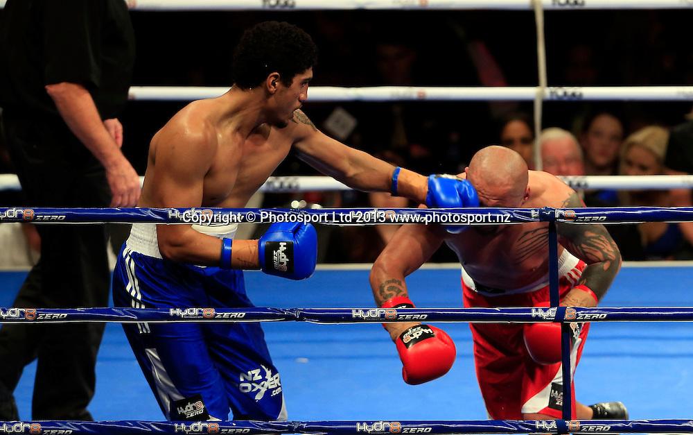 Jordan Tuigamala (blue) and Jody Allen do battle. Boxing, Hyrd8 Zero Explosion, Fight Night, Trusts Arena, Auckland, Thursday 13th June 2013. Photo: Shane Wenzlick / Photosport.co.nz