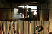 from inside lighted up window of a messy residential house Japan