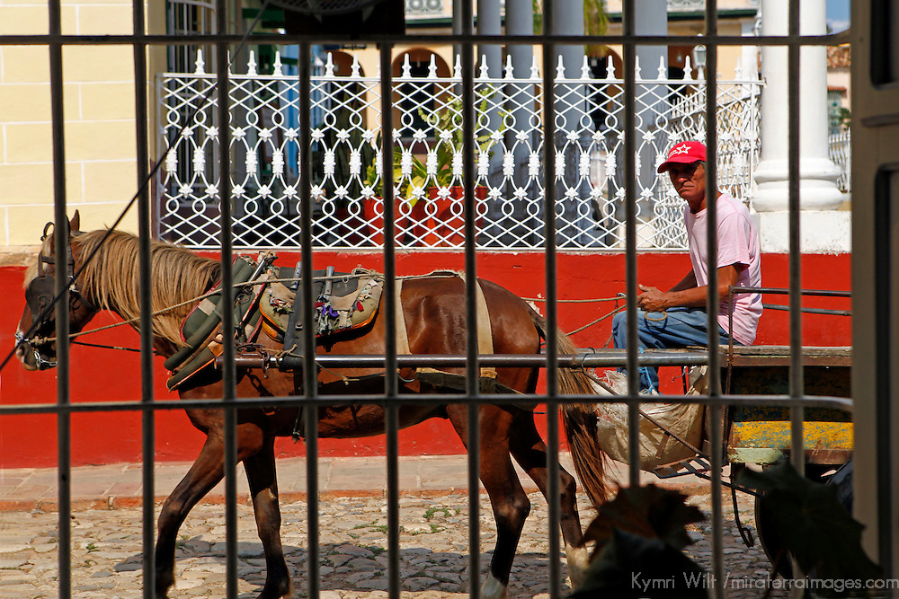 Central America, Cuba, Trinidad. Horse and cart pass on the streets of Trinidad, Cuba.