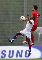20090324: FUNCHAL, MADEIRA, PORTUGAL - Portugal vs Cape Verde: XIII Madeira International Under 21 Tournament. In picture: Josi Duarte (Cabo Verde) and Miguel Vitor (Portugal) . <br />