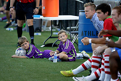 27 June 2015. New Orleans, Louisiana.<br /> National Premier Soccer League. NPSL. <br /> Jesters 1- Georgia Revolution 5.<br /> Jesters youth academy players watch on as the New Orleans Jesters lose 1-5 to the Georgia Revolution in a lightning delayed game at home in the Pan American Stadium. <br /> Photo©; Charlie Varley/varleypix.com