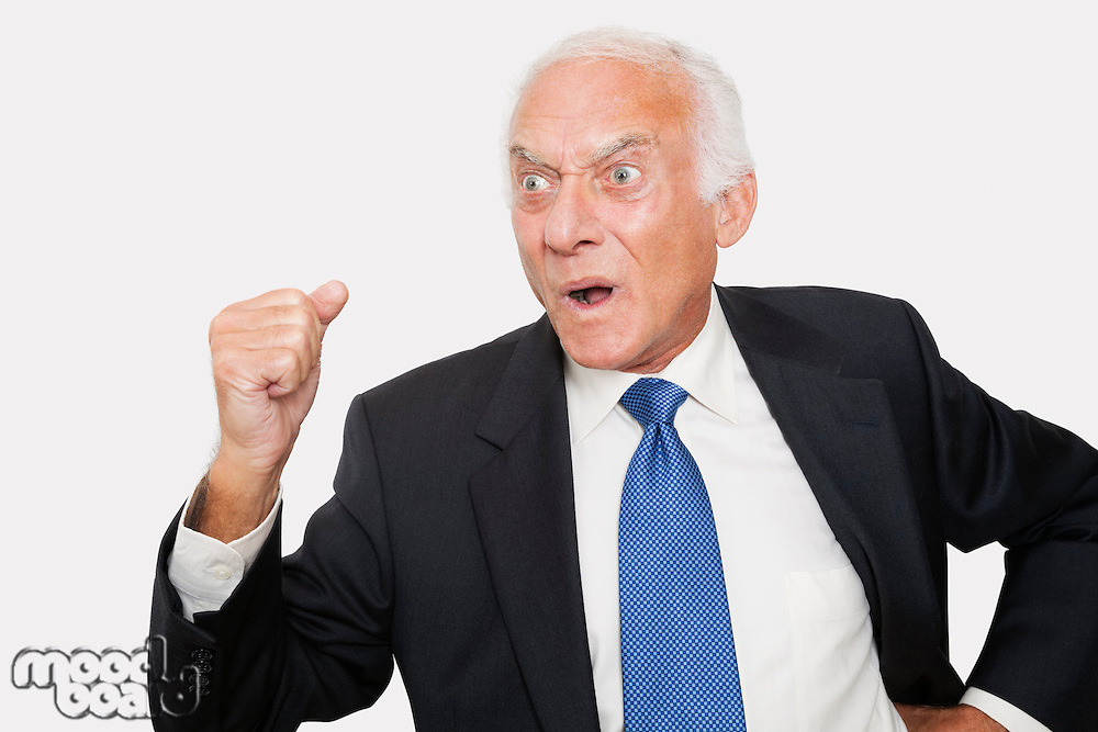 Aggressive elderly businessman against white background