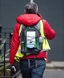 © Licensed to London News Pictures. 03/04/2020. London, UK. A man with a hand sanitiser dispenser attached to his rucksack as he walks through Whitechapel in East London, during a pandemic outbreak of the Coronavirus COVID-19 disease. The public have been told they can only leave their homes when absolutely essential, in an attempt to fight the spread of coronavirus COVID-19 disease. Photo credit: Ben Cawthra/LNP
