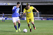 AFC Wimbledon midfielder Dean Parrett (18) and Peterborough United midfielder Callum Chettle (23) during the EFL Cup match between Peterborough United and AFC Wimbledon at ABAX Stadium, Peterborough, England on 9 August 2016. Photo by Stuart Butcher.