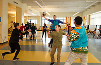 """Alex Marcano throws a pass to Nike Athlete Will McLean in a game of """"capture the football"""" during Laconia Middle School's after school program with the Nike Ambassadors.  (Karen Bobotas/for the Laconia Daily Sun)"""