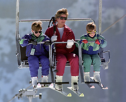 File photo dated 10/4/1991 of the Princess of Wales riding a chair lift up the Kriegerhorn with her sons Prince William, left, and Prince Harry, in Lech, Austria.