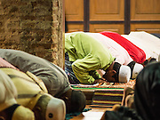 19 JUNE 2015 - PATTANI, PATTANI, THAILAND: Men pray during Ramadan services at Krue Se Mosque. Krue Se Mosque was started in 1583 but never completely finished. Ramadan is the ninth month of the Islamic calendar, and is observed by Muslims worldwide as a month of fasting to commemorate the first revelation of the Quran to Muhammad according to Islamic belief. This annual observance is regarded as one of the Five Pillars of Islam. Islam is the second largest religion in Thailand. Pattani, along with Narathiwat and Yala provinces, all on the Malaysian border, have a Muslim majority.             PHOTO BY JACK KURTZ