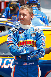 STOCKTON, CA - MAY 03:  Dylan Lupton driver of the #9 Sunrise Ford/Lucas Oil/Eibach Ford stands next to his car in the garage during practice before the NASCAR K&N Pro Series West Stockton 150 at the Stockton 99 Speedway on May 3, 2014 in Stockton, California. (Photo by Jason O. Watson/Getty Images for NASCAR) *** Local Caption *** Dylan Lupton