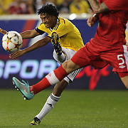 Juan Cuadrado, Colombia, shoots during the Columbia Vs Canada friendly international football match at Red Bull Arena, Harrison, New Jersey. USA. 14th October 2014. Photo Tim Clayton