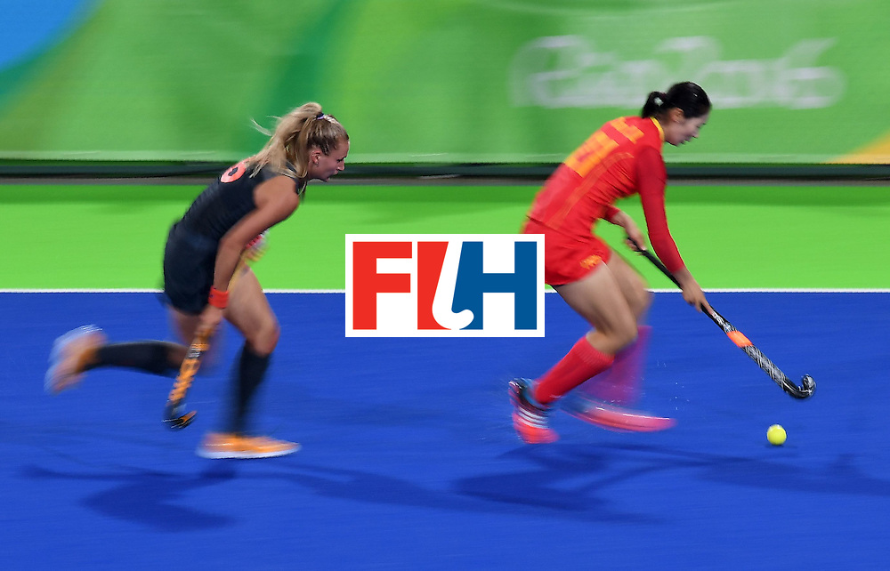 China's Zhao Yudiao controls the ball as Netherland's Laurien Leurink chases during the women's field hockey China vs Netherlands match of the Rio 2016 Olympics Games at the Olympic Hockey Centre in Rio de Janeiro on August, 10 2016. / AFP / MANAN VATSYAYANA        (Photo credit should read MANAN VATSYAYANA/AFP/Getty Images)