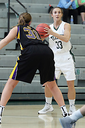 12 December 2015: Autumn Hennes defends Angela Bruno during an NCAA women's basketball game between the Wisconsin Stevens Point Pointers and the Illinois Wesleyan Titans in Shirk Center, Bloomington IL