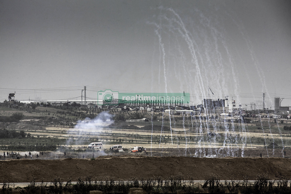 May 4, 2018 - Gaza, Palestine - Palestinian citizens of Israel and Palestinian members of the Israeli parliament protest on Friday, 4 May, 2018, near the border with the Gaza Strip against Israeli military's use of sniper fire and live ammunition on unarmed Palestinian protesters in Gaza. (Credit Image: © Mati Milstein/NurPhoto via ZUMA Press)